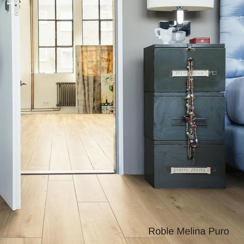 habitacion puerta abierta con suelo laminado roble melina puro tritty 90 haro pavimentos arquiservi
