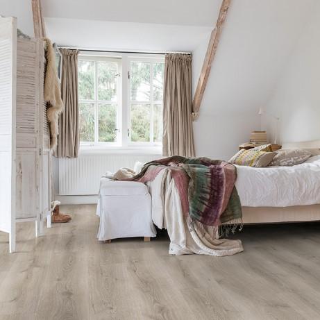habitacion con suelo laminado roble desierto gris cepillado coleccion majestic quick-step pavimentos arquiservi